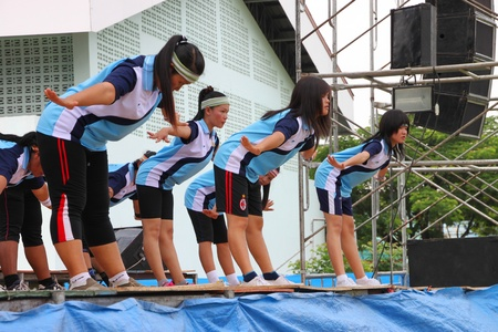 NACHUAK, MAHASARAKHAM, THAILAND - APRIL 13 : The unidentified women are performing aerobic dance in Songkran Day on April 13, 2012 at district hall plaza, Nachuak, Mahasarakham, Thailand. Stock Photo - 13154975