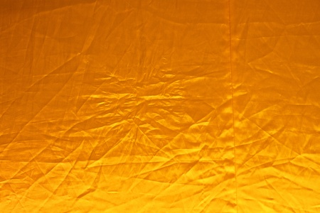 Yellow and wrinkled robe background concept for Buddhist and religious merit photo