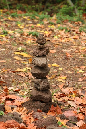 handscraft: A pile of sandstones in vertical way concept of cultural and religious growth