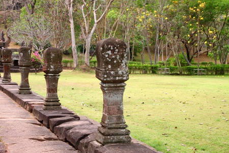 handscraft: Posts by entrance way to ancient sandstone architecture of Prasat Khao Panom Rung, Buriram, Thailand. Stock Photo