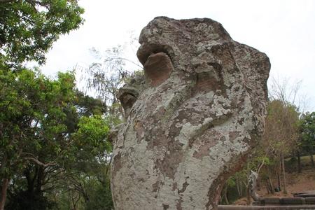 handscraft: Naga statue by entrance way to ancient sandstone architecture of Prasat Khao Panom Rung, Buriram, Thailand. Stock Photo