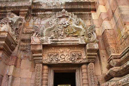 handscraft: Lintel and pediment sandstone carvings in Prasat Khao Panom Rung, Buriram, Thailand.