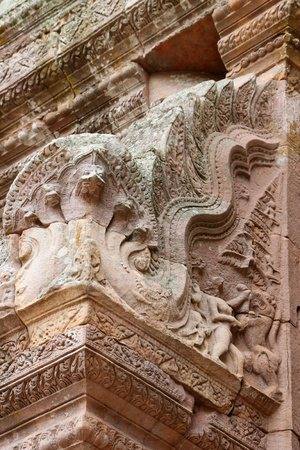 handscraft: Naga statue sandstone carvings on wall in architecture of Prasat Khao Panom Rung, Buriram, Thailand.