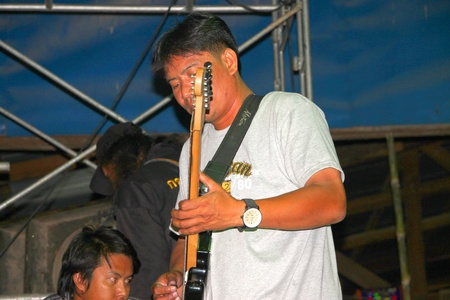 YANGSISURAT, MAHASARAKHAM, THAILAND - MARCH 22 : The unidentified man is performing local song in religious merit concert on March 22, 2012 at Ban Nong Bua Santu, Yangsisurat, Mahasarakham, Thailand.