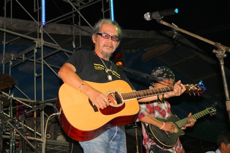 YANGSISURAT, MAHASARAKHAM, THAILAND - MARCH 22 : Mr.Nhga Caravan is performing local song in religious merit concert on March 22, 2012 at Ban Nong Bua Santu, Yangsisurat, Mahasarakham, Thailand. Stock Photo - 13257424