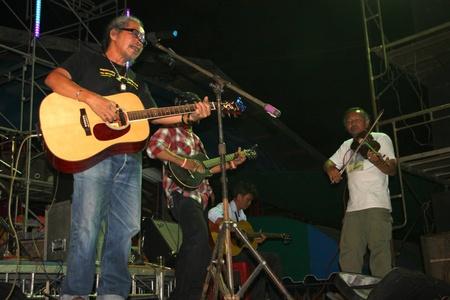YANGSISURAT, MAHASARAKHAM, THAILAND - MARCH 22 : Mr.Nhga Caravan is performing local song in religious merit concert on March 22, 2012 at Ban Nong Bua Santu, Yangsisurat, Mahasarakham, Thailand. Stock Photo - 13257426