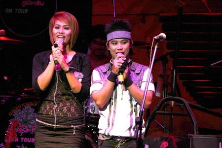 MUANG, MAHASARAKHAM - APRIL 19 : The unidentified singers are performing in concert on April 19, 2012 at Tawandang Music Hall, Muang, Mahasarakham, Thailand. Stock Photo - 13257454