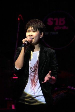 MUANG, MAHASARAKHAM - APRIL 19 : The unidentified singer is performing in concert on April 19, 2012 at Tawandang Music Hall, Muang, Mahasarakham, Thailand.