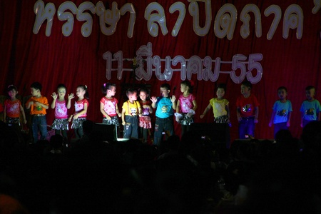 PAYAKKAPHUMPHISAI, MAHASARAKHAM, THAILAND - MARCH 11 : The unidentified children are performing modern dance in school graduation party on March 11, 2012 at city hall plaza, Payakkaphumphisai, Mahasarakham, Thailand.