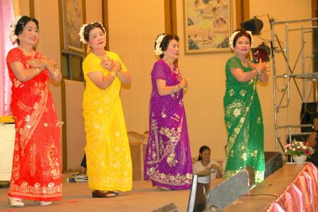MUANG, MAHASARAKHAM - APRIL 19 : The unidentified women are performing Indian dance in red cross region 5 conference on April 19, 2012 at Taksila Hotel, Muang, Mahasarakham, Thailand. Stock Photo - 13337135