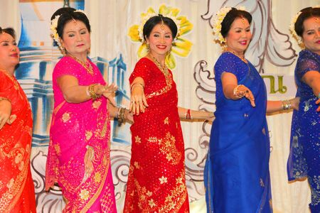 MUANG, MAHASARAKHAM - APRIL 19 : The unidentified women are performing Indian dance in red cross region 5 conference on April 19, 2012 at Taksila Hotel, Muang, Mahasarakham, Thailand. Stock Photo - 13337139