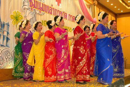 MUANG, MAHASARAKHAM - APRIL 19 : The unidentified women are performing Indian dance in red cross region 5 conference on April 19, 2012 at Taksila Hotel, Muang, Mahasarakham, Thailand. Stock Photo - 13337153