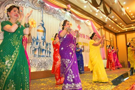 MUANG, MAHASARAKHAM - APRIL 19 : The unidentified women are performing Indian dance in red cross region 5 conference on April 19, 2012 at Taksila Hotel, Muang, Mahasarakham, Thailand.