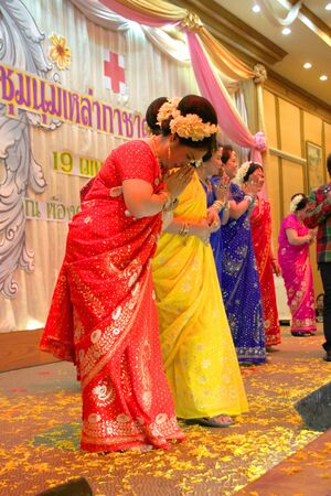 MUANG, MAHASARAKHAM - APRIL 19 : The unidentified women are performing Indian dance in red cross region 5 conference on April 19, 2012 at Taksila Hotel, Muang, Mahasarakham, Thailand. Stock Photo - 13337144