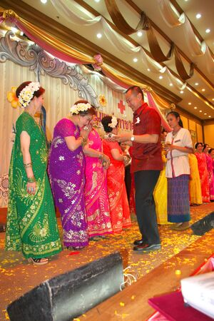 MUANG, MAHASARAKHAM - APRIL 19 : The unidentified man is giving gifts to Indian dancers in red cross region 5 conference on April 19, 2012 at Taksila Hotel, Muang, Mahasarakham, Thailand.
