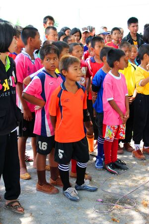 NACHUAK, MAHASARAKHAM - APRIL 18 : Unidentified children are in football training clinic on April 18, 2012 at city hall playground, Nachuak, Mahasarakham, Thailand. Stock Photo - 13365235