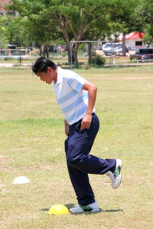 NACHUAK, MAHASARAKHAM - APRIL 18 : Unidentified coach is in football training clinic on April 18, 2012 at city hall playground, Nachuak, Mahasarakham, Thailand.
