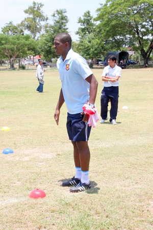 NACHUAK, MAHASARAKHAM - APRIL 18 : Unidentified striker is in football training clinic on April 18, 2012 at city hall playground, Nachuak, Mahasarakham, Thailand. Stock Photo - 13365275