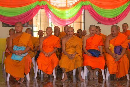 NACHUAK, MAHASARAKHAM - APRIL 10 : Unidentified Buddhist monks are in religious merit activities on April 10, 2012 at Wat Nong Kung, Nachuak, Mahasarakham, Thailand. Stock Photo - 13365248