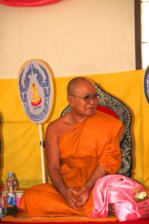 mahasarakham: NACHUAK, MAHASARAKHAM - APRIL 10 : Unidentified Buddhist monk is in religious merit activities on April 10, 2012 at Wat Nong Kung, Nachuak, Mahasarakham, Thailand.