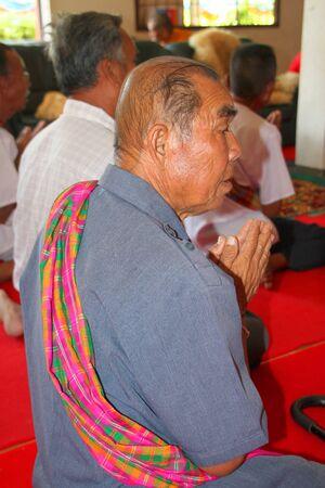 mahasarakham: NACHUAK, MAHASARAKHAM - APRIL 10 : Unidentified Buddhist is in religious merit activities on April 10, 2012 at Wat Nong Kung, Nachuak, Mahasarakham, Thailand.