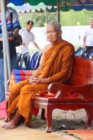 mahasarakham: NACHUAK, MAHASARAKHAM - APRIL 28 : Unidentified Buddhist monk is in ceremony of pouring liquid brass into Buddha mold on April 28, 2012 at Wat Hua Sra, Nachuak, Mahasarakham, Thailand.