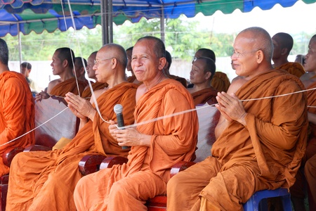 mahasarakham: NACHUAK, MAHASARAKHAM - APRIL 28 : Unidentified Buddhist monks are in ceremony of pouring liquid brass into Buddha mold on April 28, 2012 at Wat Hua Sra, Nachuak, Mahasarakham, Thailand. Editorial