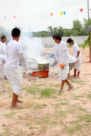 mahasarakham: NACHUAK, MAHASARAKHAM - APRIL 28 : Unidentified Buddhists are pouring liquid brass into Buddha mold on April 28, 2012 at Wat Hua Sra, Nachuak, Mahasarakham, Thailand.