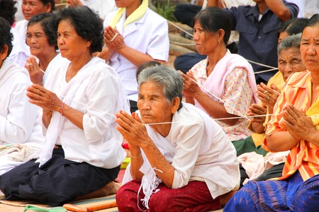 mahasarakham: NACHUAK, MAHASARAKHAM - APRIL 28 : Unidentified Buddhists are in ceremony of pouring liquid brass into Buddha mold on April 28, 2012 at Wat Hua Sra, Nachuak, Mahasarakham, Thailand.
