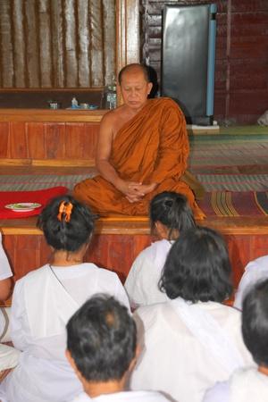mahasarakham: NACHUAK, MAHASARAKHAM - APRIL 28 : Unidentified Buddhists are making religious merit in ceremony of pouring liquid brass into Buddha mold on April 28, 2012 at Wat Hua Sra, Nachuak, Mahasarakham, Thailand.