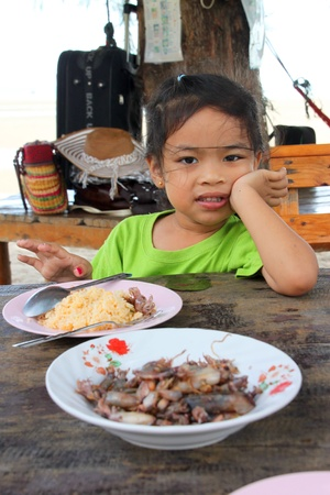 CHANTA BURI, THAILAND - APRIL 21 : Unidentified girl is at lunch time on April 21, 2012 at Chao Lhao Beach, Chanta Buri, Thailand. Stock Photo - 13455412