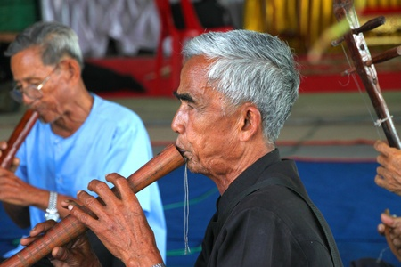 YANGSRISURAT, MAHASARAKHAM - MARCH 22 : Unidentified old men are performing traditional Thai grand orchestra in ordination ceremony on March 22, 2012 at Wat Nongbuasantu, Yangsrisurat, Mahasarakham, Thailand. Stock Photo - 13491278