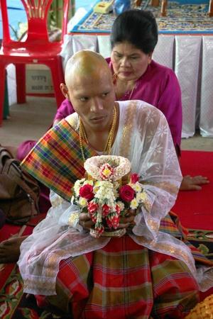 kinfolk: YANGSRISURAT, MAHASARAKHAM - MARCH 22 : Unidentified man in naga clothes is in ordination ceremony on March 22, 2012 at Wat Nongbuasantu, Yangsrisurat, Mahasarakham, Thailand. Editorial