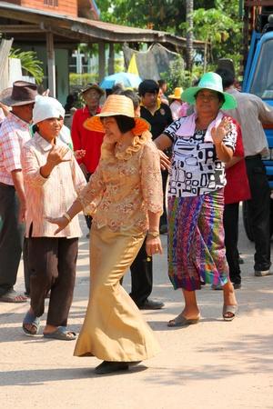 YANGSRISURAT, MAHASARAKHAM - MARCH 22 : Unidentified close relatives are in procession of ordination ceremony on March 22, 2012 at Wat Nongbuasantu, Yangsrisurat, Mahasarakham, Thailand. Stock Photo - 13491312
