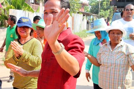 YANGSRISURAT, MAHASARAKHAM - MARCH 22 : Unidentified close relatives are in procession of ordination ceremony on March 22, 2012 at Wat Nongbuasantu, Yangsrisurat, Mahasarakham, Thailand. Stock Photo - 13491315