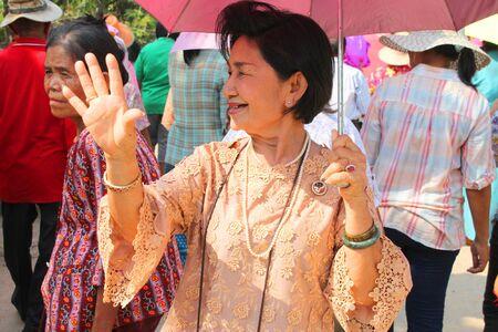 YANGSRISURAT, MAHASARAKHAM - MARCH 22 : Unidentified woman is dancing in procession of ordination ceremony on March 22, 2012 at Wat Nongbuasantu, Yangsrisurat, Mahasarakham, Thailand. Stock Photo - 13491320