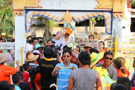 YANGSRISURAT, MAHASARAKHAM - MARCH 22 : Unidentified Buddhists in procession of ordination ceremony are coming in temple on March 22, 2012 at Wat Nongbuasantu, Yangsrisurat, Mahasarakham, Thailand. Stock Photo - 13491325