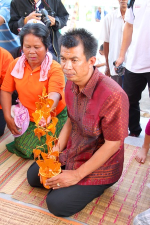YANGSRISURAT, MAHASARAKHAM - MARCH 22 : Unidentified father of naga is in ordination ceremony on March 22, 2012 at Wat Nongbuasantu, Yangsrisurat, Mahasarakham, Thailand. Stock Photo - 13491309