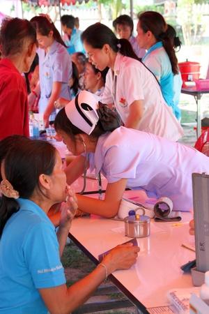 public hospital: NACHUAK, MAHASARAKHAM - APRIL 19 : Unidentified nurses from public hospital are in medical services on April 19, 2012 at Wat Nong Bung, Nachuak, Mahasarakham, Thailand. Editorial