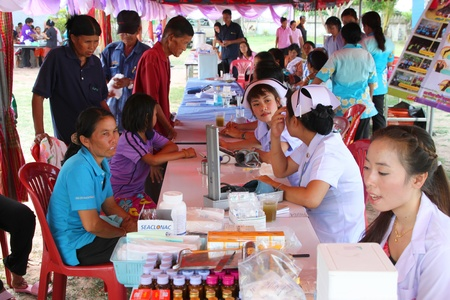 NACHUAK, MAHASARAKHAM - APRIL 19 : Unidentified nurses from public hospital are in medical services on April 19, 2012 at Wat Nong Bung, Nachuak, Mahasarakham, Thailand. Stock Photo - 13491302