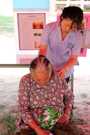 NACHUAK, MAHASARAKHAM - APRIL 19 : Unidentified nurse from public hospital is in medical services on April 19, 2012 at Wat Nong Bung, Nachuak, Mahasarakham, Thailand.