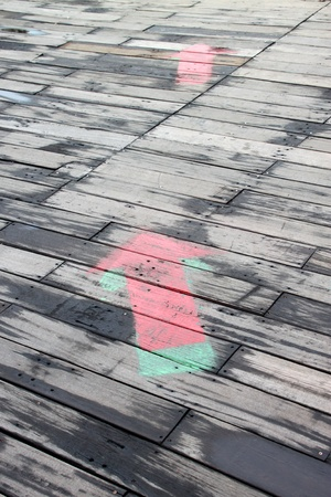 arrows on wooden floor showing the direction photo