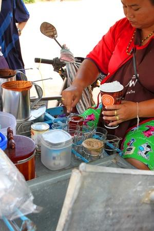 stiring: TAPHRAYA, SRA KAEO - MAY 13 : Unidentified woman is stiring tea and selling it on May 13, 2012 at Ban Klong Yang, Taphraya, Sra Kaeo, Thailand.