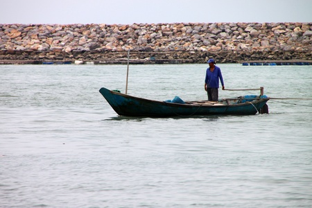BAN PHE, RAYONG - MAY 9 : Unidentified man is on the fishing boat on May 9, 2012 at Ban Phe ferry port, Rayong, Thailand.