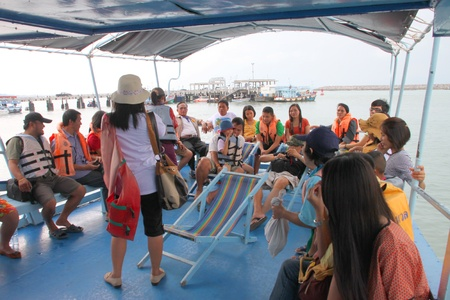 BAN PHE, RAYONG - MAY 9 : Unidentified tourists are traveling to Koh Samet on May 9, 2012 at Ban Phe ferry port, Rayong, Thailand.