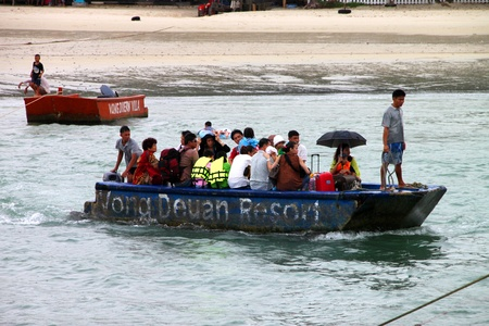 KOH SAMET, RAYONG - MAY 9 : Unidentified tourists are changing little boat to big ship on May 9, 2012 at Koh Samet, Rayong, Thailand.