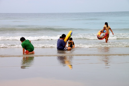 BAN PHE, RAYONG - MAY 10 : Unidentified tourists are playing on the beach on May 10, 2012 at Ban Phe sea shore, Rayong, Thailand.