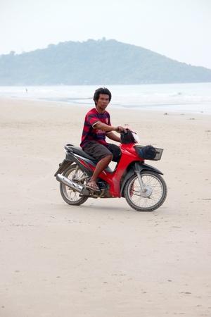 BAN PHE, RAYONG - MAY 10 : Unidentified man is riding motorcycle on the sand beach on May 10, 2012 at Ban Phe sea shore, Rayong, Thailand.