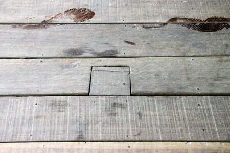 Wooden plank floor with two sandal footprints photo