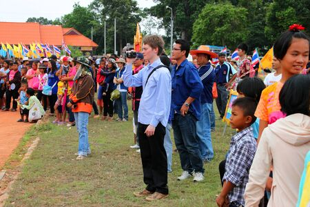 PAYAKKAPHUMPHISAI, MAHASARAKHAM - MAY 19 : Unidentified tourists are in traditional north-east Thai sky rocket ceremony and festival on May 19, 2012 at footbal playground, Payakkaphumphisai, Mahasarakham, Thailand. Stock Photo - 13847150